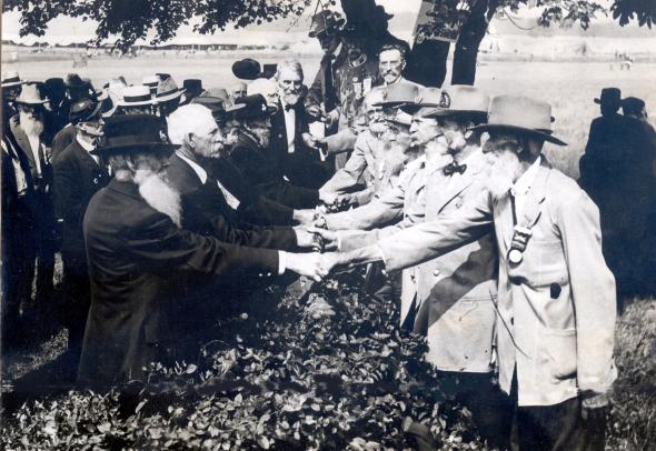 Former enemies shake hands at the 1913 Reunion